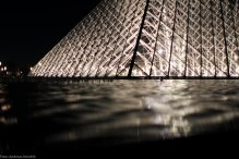 Louvre Pyramide by night water crystal symmetric
